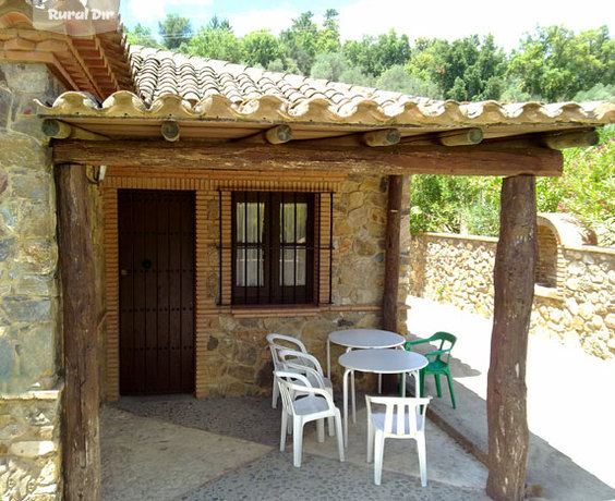 Casa rural casa de piedra cortegana huelva for Fotos de casas de campo con porche